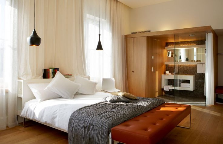 Pendant next to bed. Gorgeous Boutique Hotel With Elegant And Artistic Touch In Details: Astounding BE Hotel Bedroom Furnishing With Modern Bed With Shelves On H...
