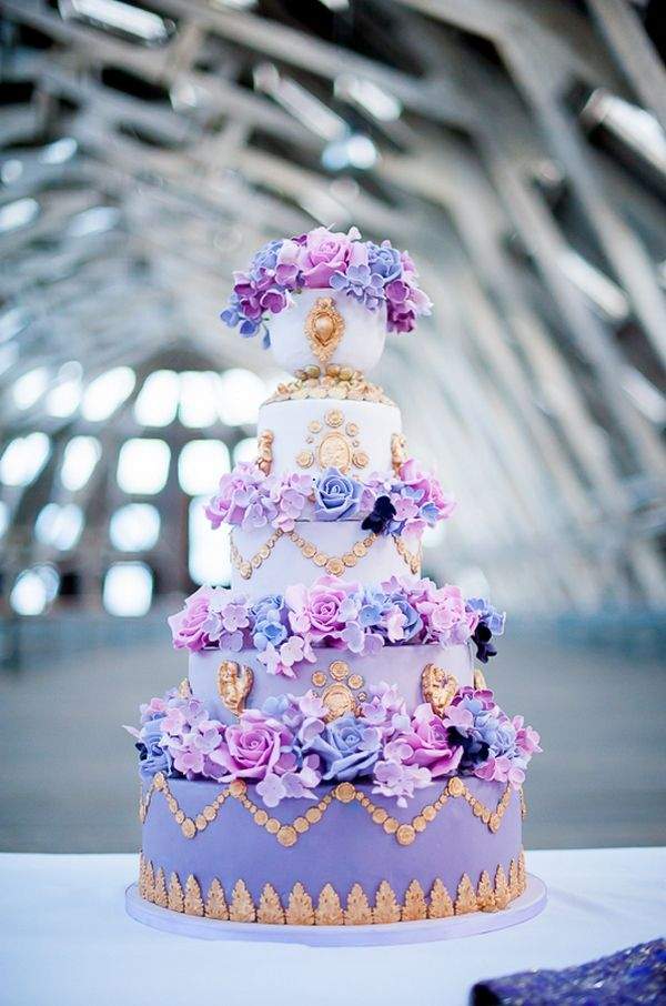 Beautiful Detailed Purple Wedding Cake with Flowers and Gold Detail