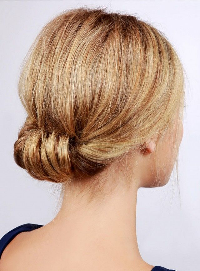 We love the chic-meets-casual look of this low rolled updo that's perfect for summer date night. Click here for the full tutorial.