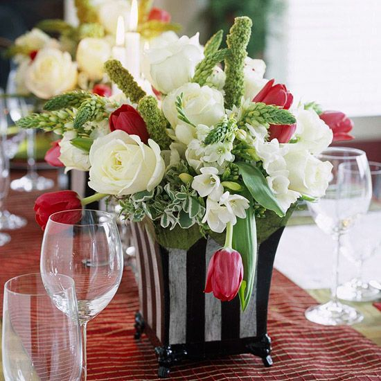 Full and merry, this arrangement welcomes the season in style. Gorgeous red tulips, fluffy white roses, and perky pieces of Star-of-Bethlehem blend to make a bountiful arrangement.