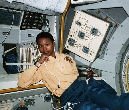 Dr. Mae Jemison, traveling in space as a NASA astronaut and the first black woman to do so.