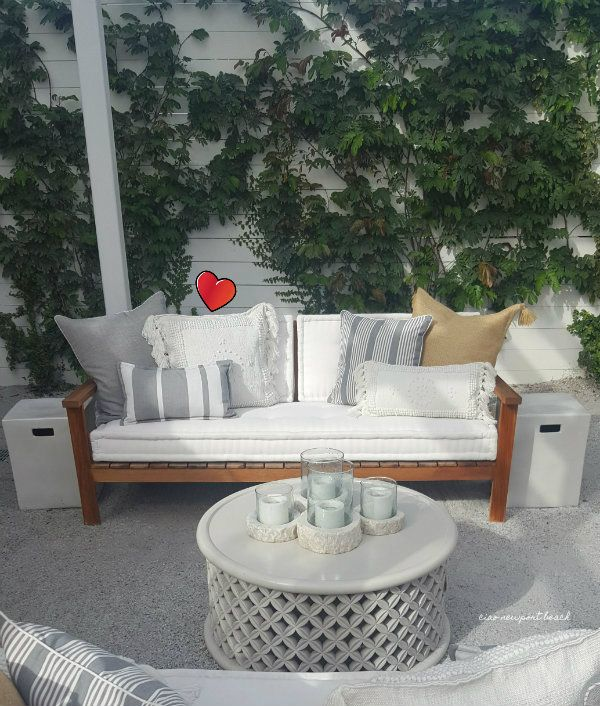 A cozy seating arrangement is nestled next to the trickling outdoor fountain and pretty climbing vines.  I came home with a couple of these Montecito pillows that you see above.  They're actually indoor outdoor pillows and they have a perfectly nubby texture and pattern that reminds me of a white kilim rug.