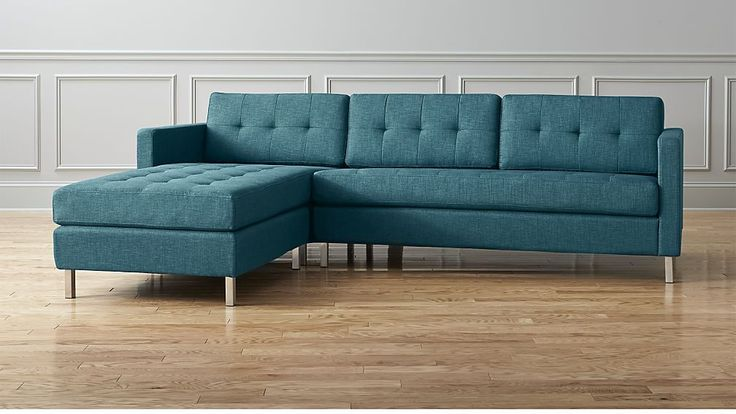ditto II peacock sectional sofa | CB2 While definitely more contemporary (v. mid-century) the tufting on this gives a retro feel (like your house) and this peacock blue is really nice.  Does not come in a non-sectional style.