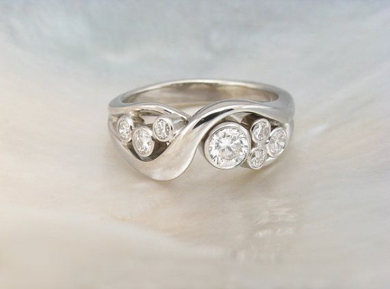 bezel set bubble diamond ring in 14k white gold  by RavensRefuge, Something like this maybe with saphires or tourmaline set into the center...