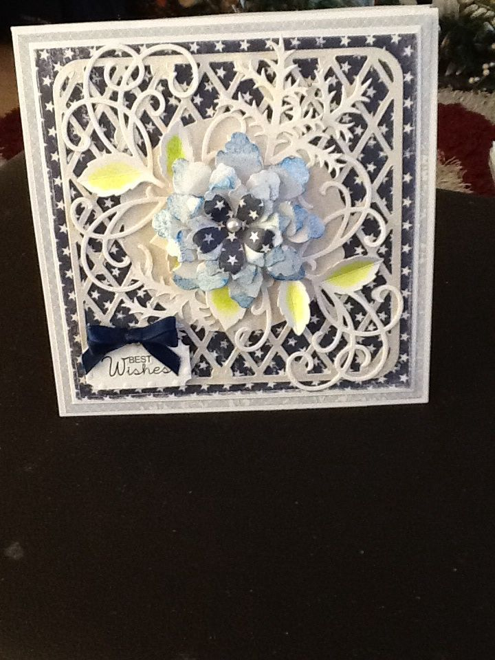 This is a hinged card made with the Grand Square dies. The backing paper is from Maja papers