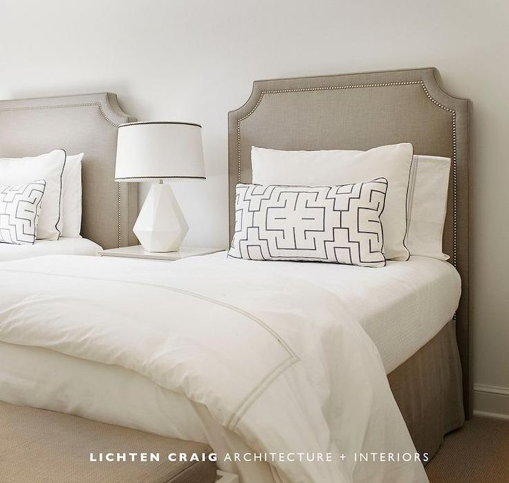 Monochromatic shared bedroom features twin taupe headboards accented with nailhead trim on beds dressed in taupe embroidered bedding
