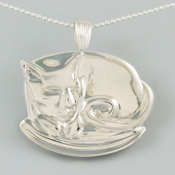 Coffee Cat: Made of 100% recycled sterling silver this reversible pendant measures about 1 inch wide and features a swivel action so that it can be switched without taking off the necklace.  themercurius.com