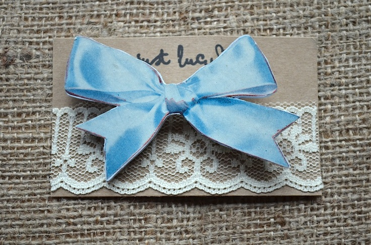 Pretty Bow Brooch  £14  Extremely unique wooden brooch decorated with a vintage paper bow from the 1920's. Appears 3D but in fact totally 2D!!!   www.justlucy.bigcartel.com
