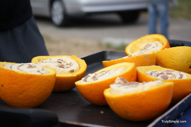 After eating the slices of oranges, use the rinds to make cinamon rolls over the campfire. Hello awesome!