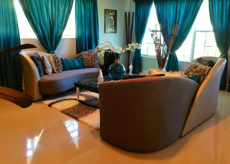 Elegant living room in teal silver and black decor for Black and brown living room designs