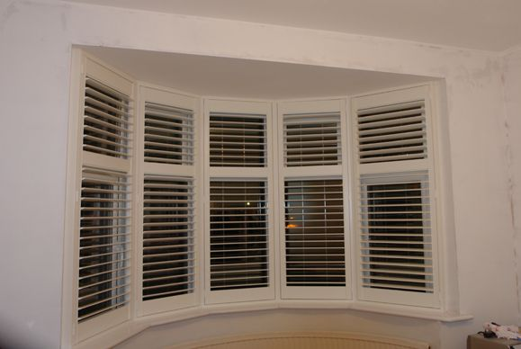 Curved,bay shutters image 1