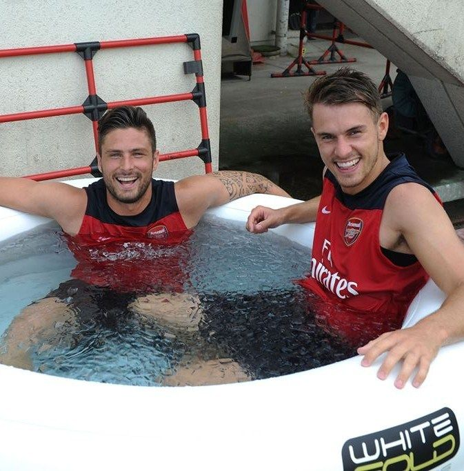 Cooling off! Olivier Giroud and Aaron Ramsey recover in an ice bath after another gruelling training session in Japan.