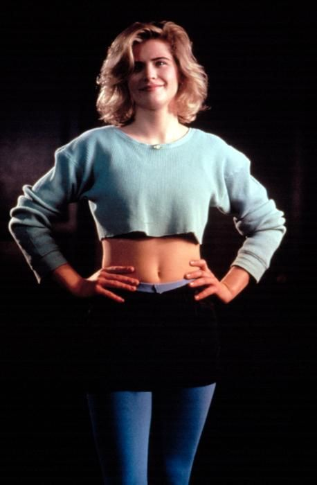 """Kristy Swanson in one of many outfits in her """"getting into vampire slaying shape montage"""" in Buffy the Vampire Slayer 1992"""
