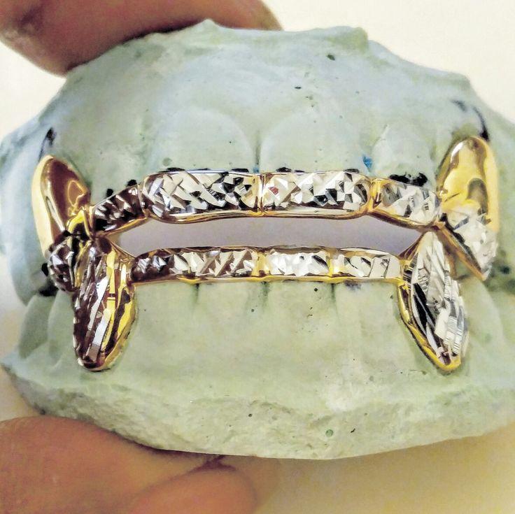 Bridge bar grillz top and bottom with diamond cuts..  Custom fit gold teeth 6k - 22k gold silver or platinum  www.ChiGrillz.com