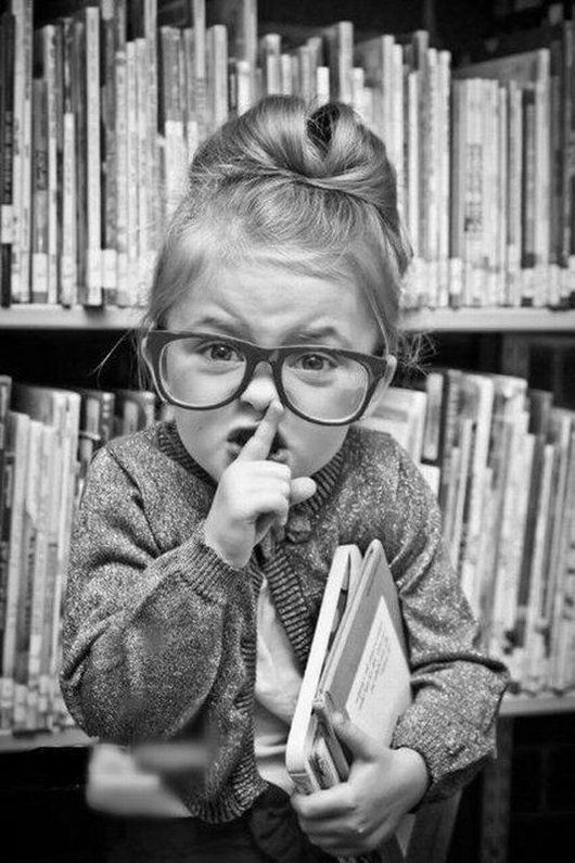 Writing Prompt: Who is the girl telling to be quiet? Does she work at the library? Is she mad at the person making noise?