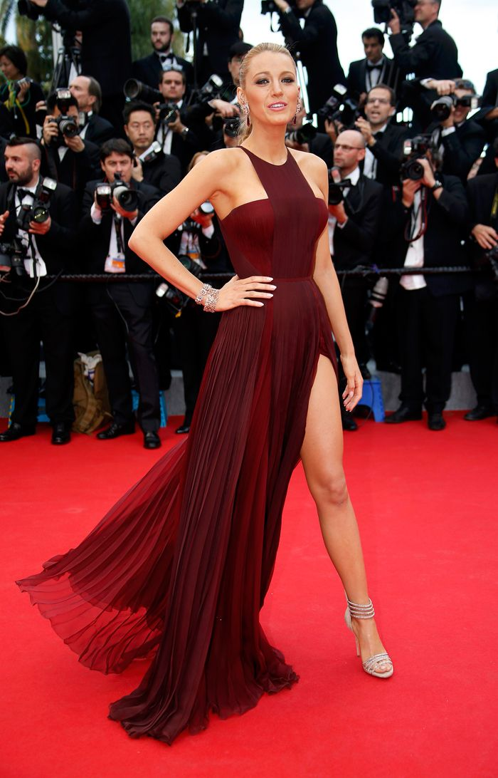 'Gossip Girl' Blake Lively made heads turn with her bold burgundy gown with a thigh-high slit by Frida Gianni. Seen here, the actress poses for the red carpet Angelina Jolie style, as she arrived for the opening ceremony of the 67th Cannes Film Festival and the screening of the 'Grace of Monaco'. (Source: Reuters)