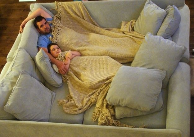 The DIY Home Theater Way - couch movie pit made by putting 2 of the same couches together.. plus | 19 Couches That Ensure You'll Never Leave Your Home Again