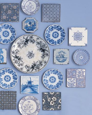 a collection of Delft tiles and transferware plates