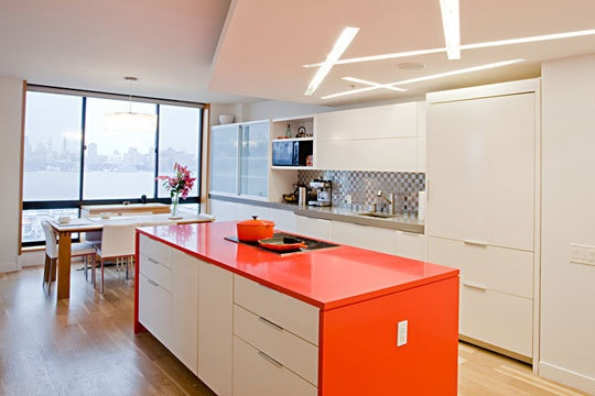 Very cool modern kitchen. Love the strange bold use of color. Love the abstract nonsensical lighting. The table and chairs are nice and simple as well.
