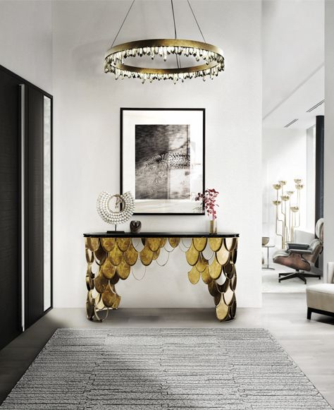 KOI Console Table by Brabbu | Brass console table which fits in any modern home decor. The KOI scales from the sides of the modern console table shine and reflect the sun on its brass surface. Find more: https://www.brabbu.com/en/casegoods/koi-console/