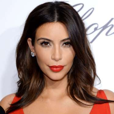 The sultry siren made jaws drop with her effortless waves and knockout red lippie. - Karwai Tang/WireImage