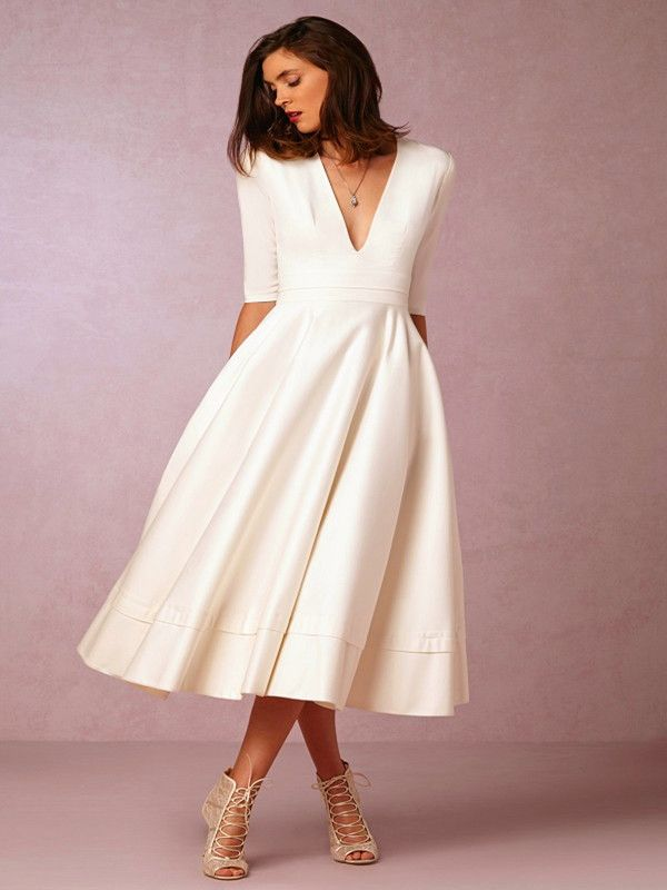 Tea Length Ivory Dress with Three Quarter Sleeves and Plunging Neckline - How to Select Wedding Dresses for the Mature Bride - EverAfterGuide