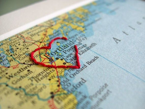 "Print a Google map and embroidery a heart around the city name. Glue to scrapbook layout. Would work well either as a travel page or a ""home"" page or a favorites page."