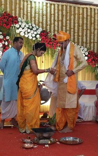 Traditional wedding dress of Maharashtrian bride and bridegroom for pheras