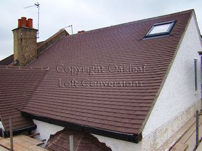 Roofing work complete, gable wall has been rendered and painted