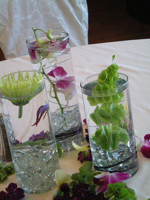 beta fish centerpieces! I like this idea because in my first date with Vic we bought Beta fish lol