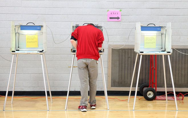 First-time voter Aleksei Sorensen casts his ballot at Shorewood High School on April 1.