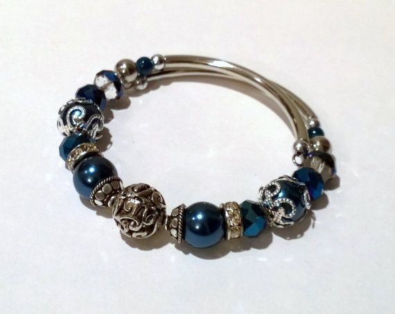 Memory Wire Bracelet. Inspired by trendy charm bracelets, this dark blue bracelet blends the classic look of pearls with a modern look and feel. by ToPolishOrNot?