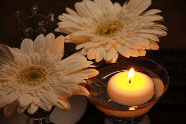 Gerberas and floating candles in martini glasses www.iceevents.co.za