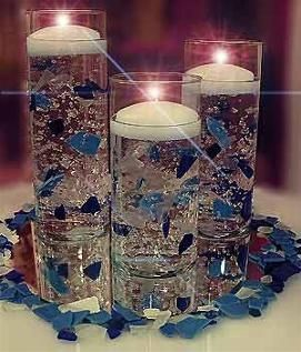 Water Gelatin with Blue Confetti and Floating Candles centerpiece. YES! EXACTLY! Do this with royal blue & bright green confetti, a few more pieces than the picture, and silver sparkles at the base instead of those confetti petals.