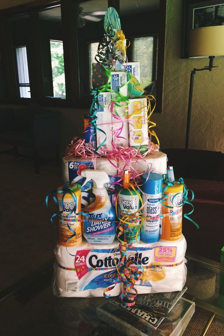 """A """"cake"""" made from cleaning supplies — great gift for someone moving into a new place!:"""