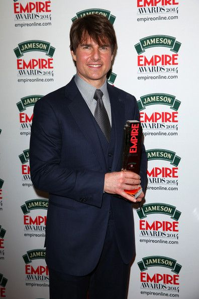 "Tom Cruise Photos Photos - Tom Cruise with the ""Legend Of Our Lifetime"" award during the Jameson Empire Awards 2014 at the Grosvenor House Hotel on March 30, 2014 in London, England. Regarded as a relaxed end to the awards show season, the Jameson Empire Awards celebrate the film industry's success stories of the year with winners being voted for entirely by members of the public. Visit empireonline.com/awards2014 for more information. - Jameson Empire Awards 2014 Press Room"