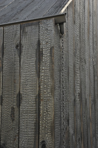 shou sugi ban siding with Gutter detail and chain down spout