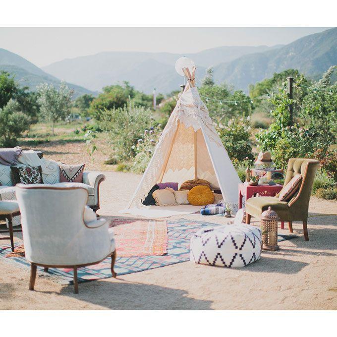 Brides.com: 16 Wedding Lounge Areas We Love A boho-inspired lounge area with a teepee.Photo: Katie Pritchard