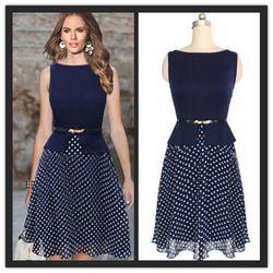 Elegant boat neck, rich color, flirty not-too-short skirt