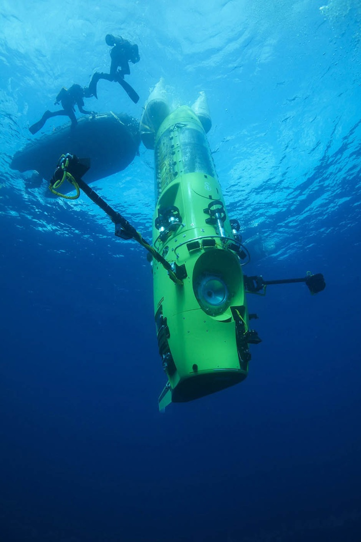 See James Cameron emerge from the deepest point on Earth after taking a submarine to the Mariana Trench