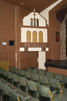 Auditorium seating and 'little house' to left of screen.