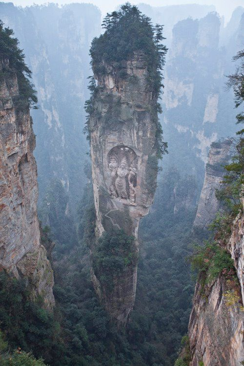 Avatar Hallelujah Mountain (Formerly Known As: Southern Sky Column). In Wulingyuan National Park in Zhangjiajie of China's Hunan Province. I was later told after pinning this that the sculpture is Photoshopped. Here is another photos of it: http://tal.al/blog/25-most-amazing-places-on-earth-you-must-visit-121