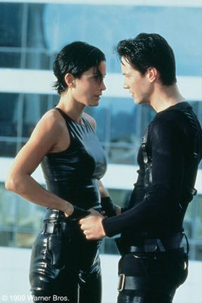 The Matrix - Carrie-Anne Moss and Keanu Reeves in Warner Brothers' The Matrix.. Classico Muito foda