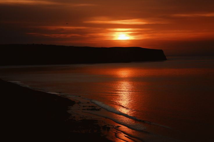 Sunset over Whitby Bay.  Taken last year we were fortunate to witness some glorious weather and truly colourful and saturated sunsets.