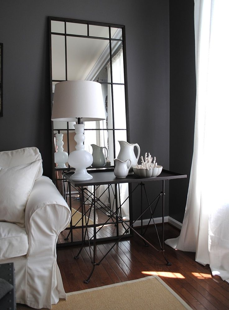 love this long mirror behind the table and love this wall color | charcoal gray | sherwin williams | gauntlet gray and large mirror behind table
