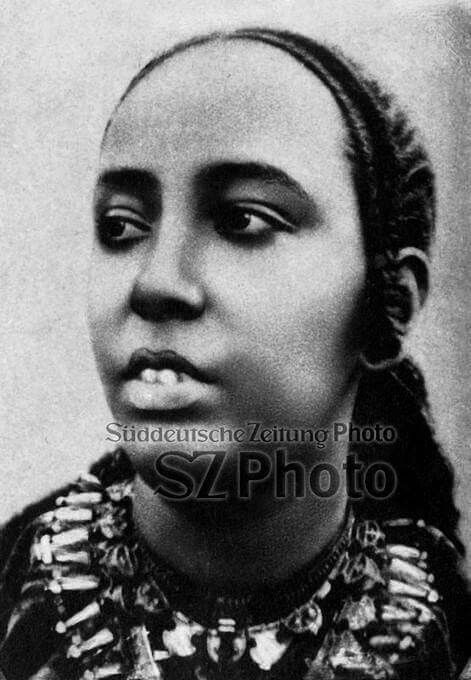 This could be a rare 1880s younger version of Empress Taitu Bitul of Ethiopia  The source French caption says: 'Taitu- Imperatrice d Abyssine'   Empress Taitu, the loyal wife of Emperor Menelik, was born in Wollo from a powerful family of Yeju Oromo origin. She was the Emperor's confidante, a commander and military strategist  Taitu had her own battalion of about 5000 which she bravely commanded against Italy during the 1896 battle of Adwa. She fought in the front-line motivating men against…