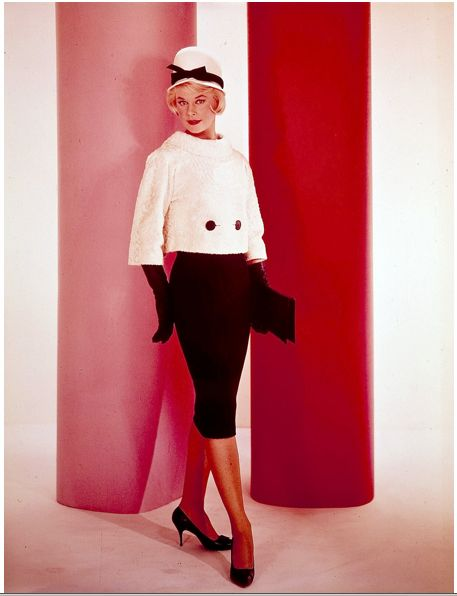 Doris Day wearing my favorite outfit from Lover Come Back.  The jacket buttons in the front attaching to the dress, while the back is open, only closed with one button at the top.  A very clever design.  I would love to get my hands on this dress today.
