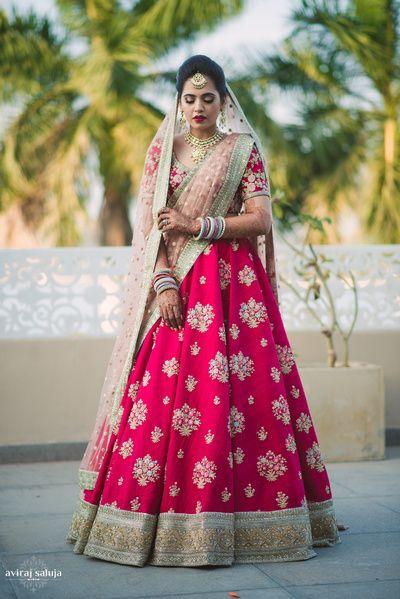 Bridal Lehengas - Coral Wedding Lehenga with Double Net Peach and Geen Dupatta | WedMeGood  #wedmegood #indianbride #indianwedding #lehenga #coral #bridal