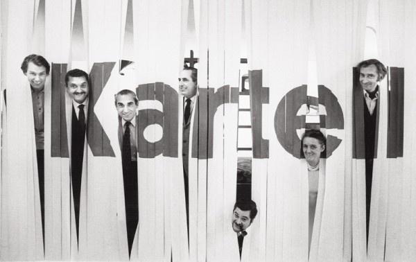 Salone del Mobile, Milano 1969. From the left: Olaf von Bohr, Gino Colombini, Alberto Rosselli, Ignazio Gardella, Joe Colombo, Anna Castelli Ferrieri, Giotto Stoppino. Photo Ugo Mulas © Eredi Ugo Mulas.