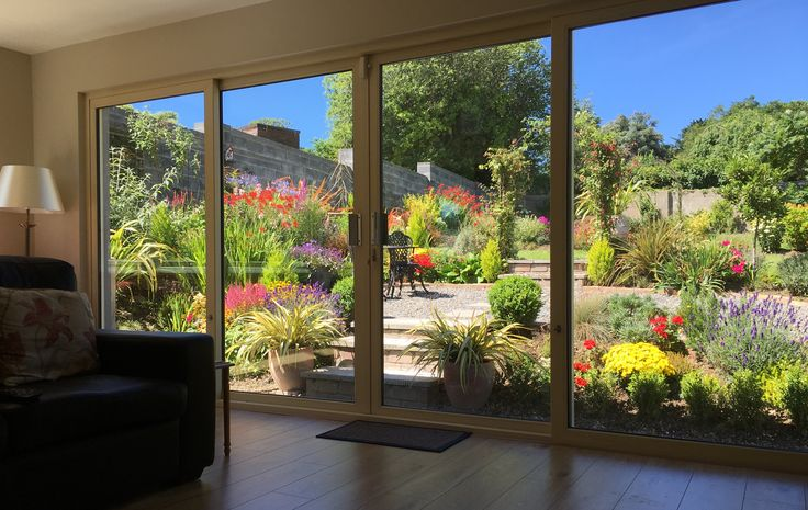 Our garden in summer of 2016 taken from inside our just completed house extension.
